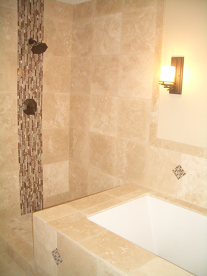 Natural stone and glass tile master bathroom installation in Fort Collins, Colorado