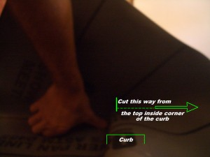 Cutting a liner for curb when using a topical membrane