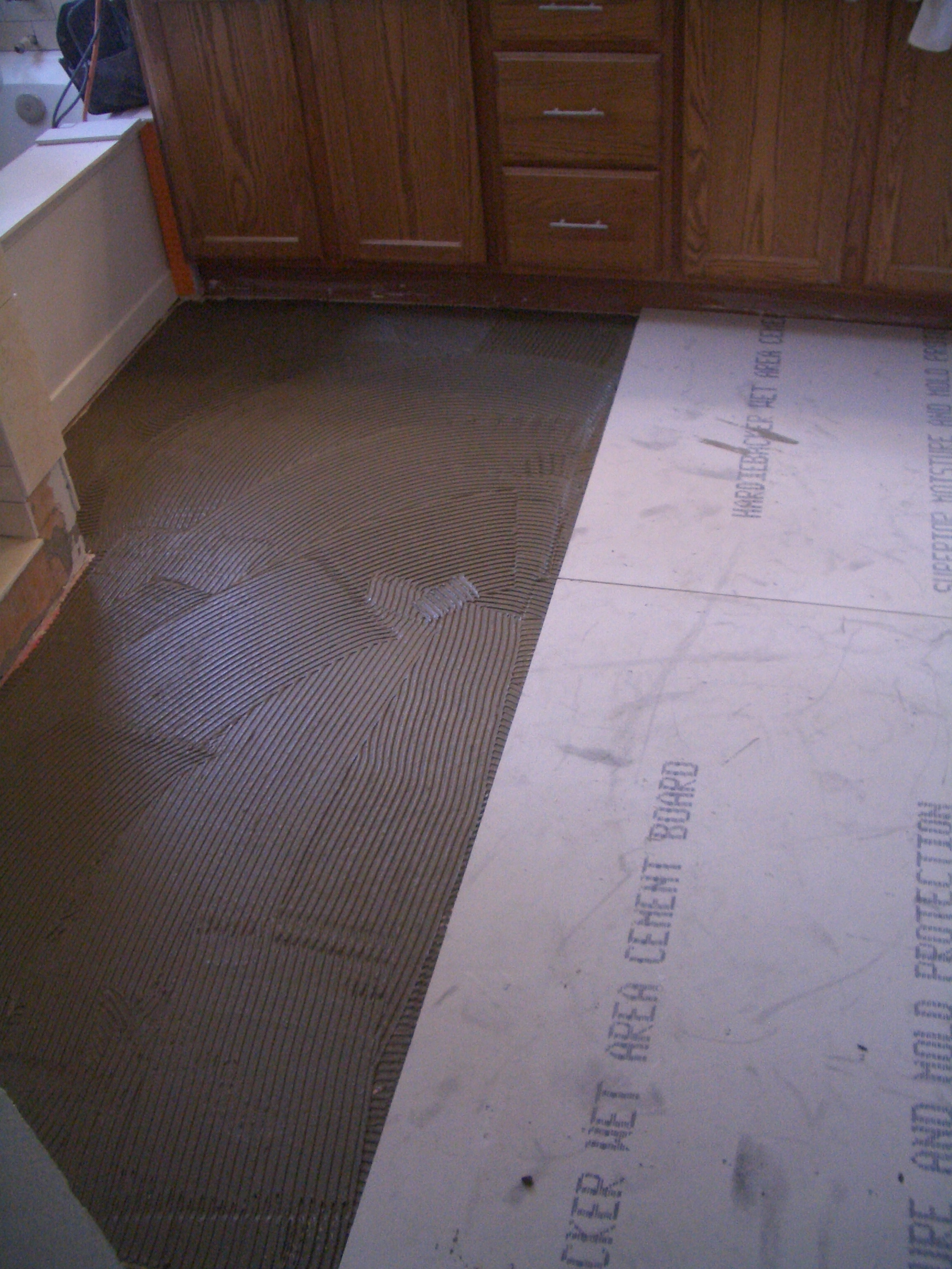 To install cement backerboard for floor tile installing thinset beneath backerboards dailygadgetfo Gallery