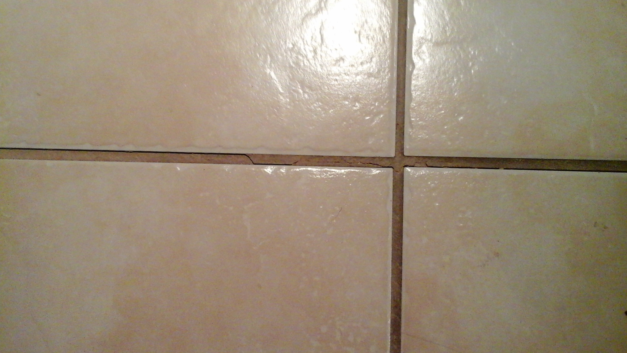 Floor tile grout cracking