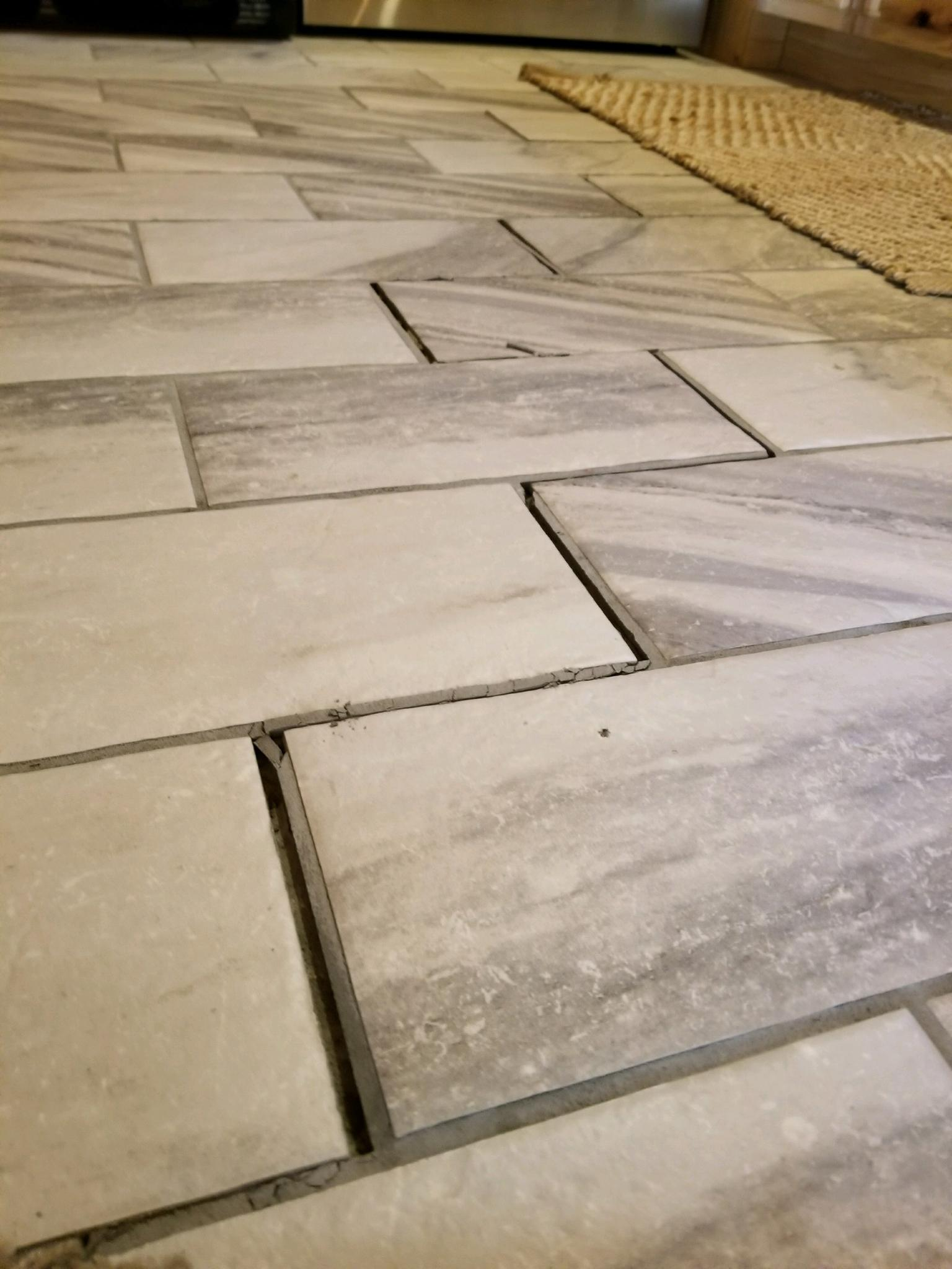 Why is my floor grout cracking could this be the home settling or something worse can we just re grout those areas thank you i included a photo dailygadgetfo Image collections