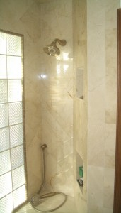 Marble shower over-under niches in on-point shower