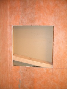 Inserting the horizontal framing for a tiled shower niche