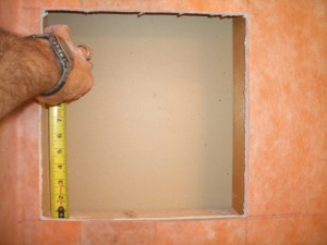 Top and bottom framing for tiled shower niche