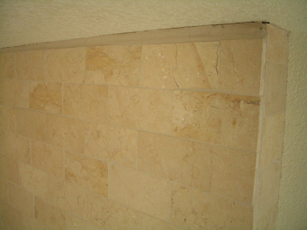 One inch grout line against ceiling - lack of planning