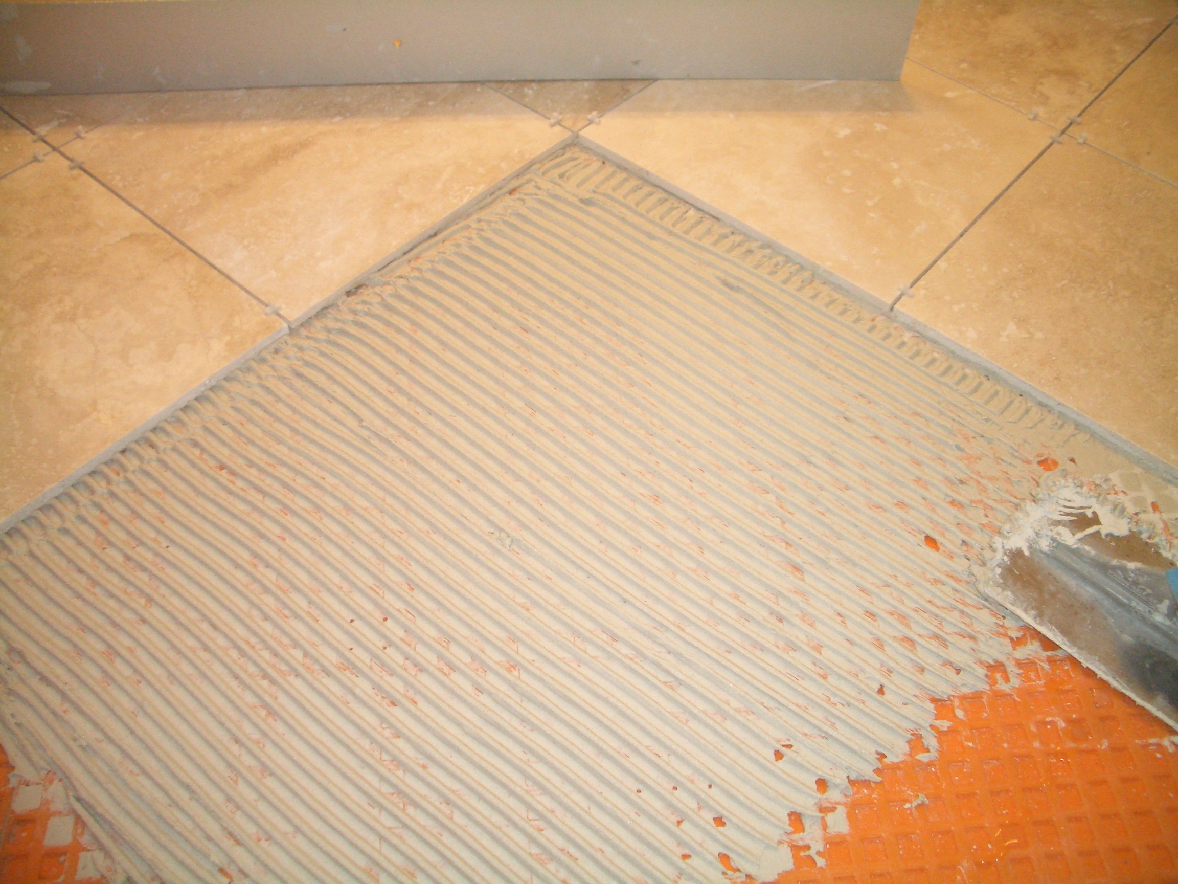 To install absolutely flat floor tile thinset lines all combed consistently dailygadgetfo Images