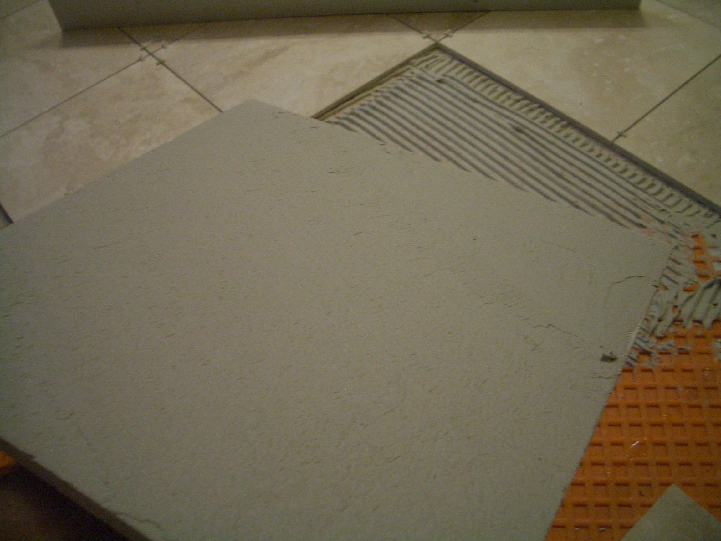 How to install absolutely flat floor tile backbuttered travertine tile completely filled dailygadgetfo Choice Image