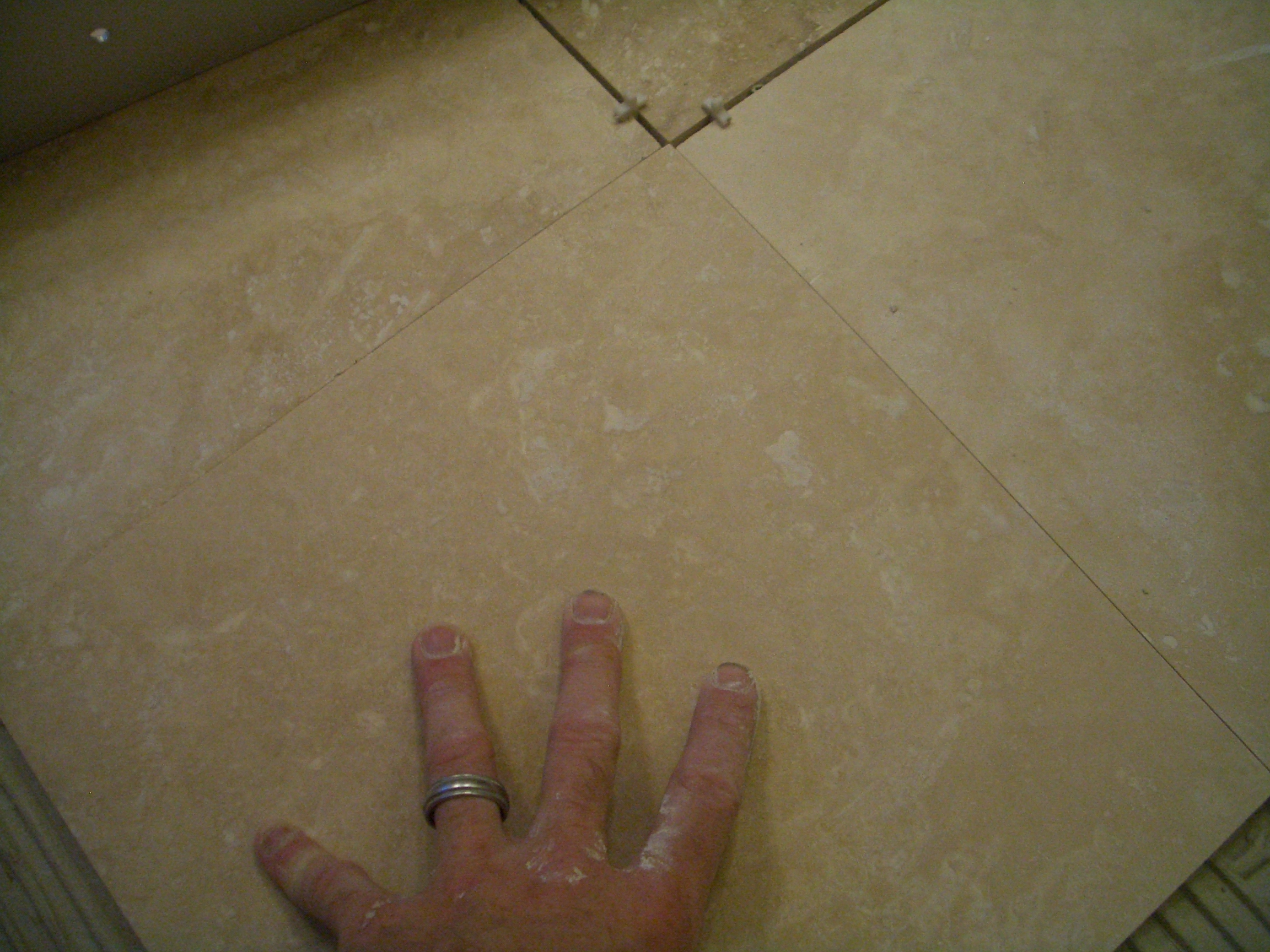 How to install absolutely flat floor tile placing tile directly against adjacent tiles dailygadgetfo Choice Image