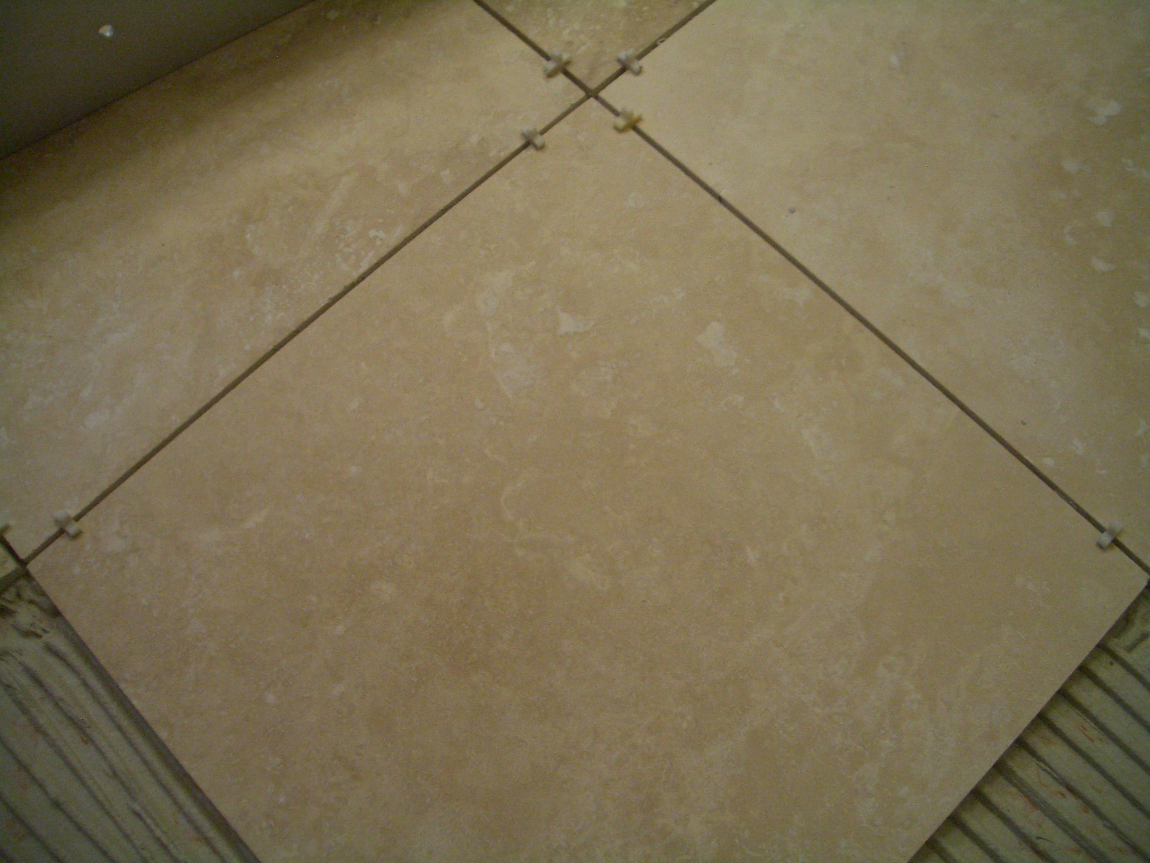 To install absolutely flat floor tile insert spacers and you have an absolutely flat floor dailygadgetfo Choice Image