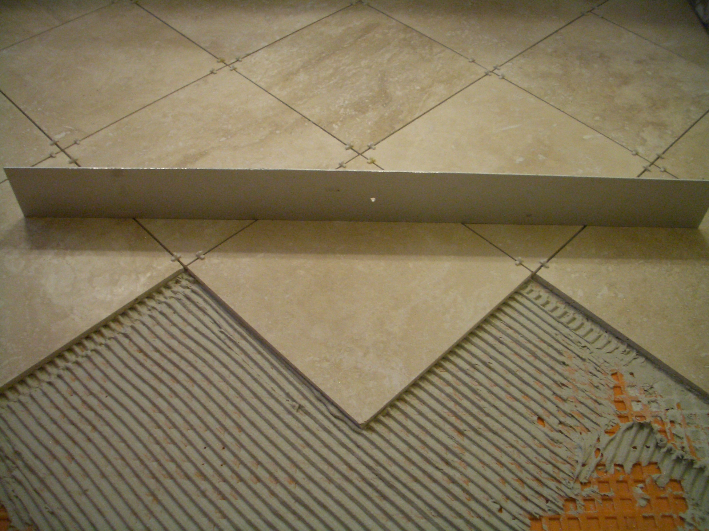 How to install absolutely flat floor tile check with a straight edge told you absolutely flat dailygadgetfo Choice Image