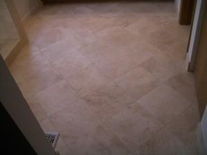 Absolutely flat travertine tile bathroom floor