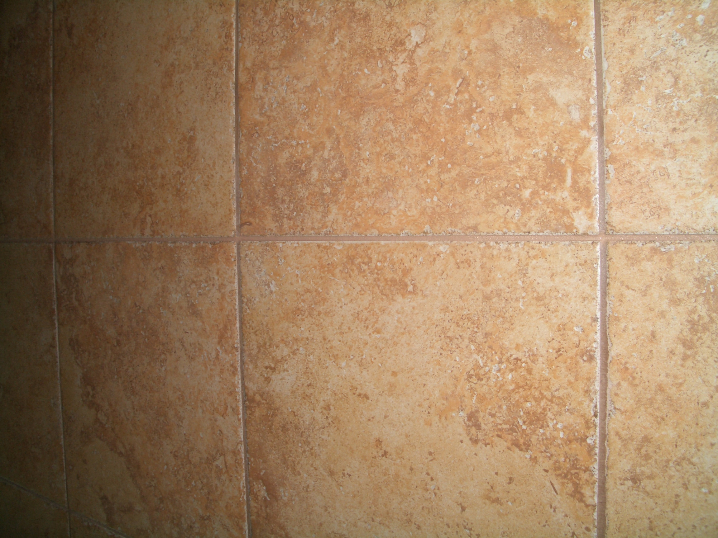 How to install a control joint in a tile installation completed control joint in tile installation dailygadgetfo Images