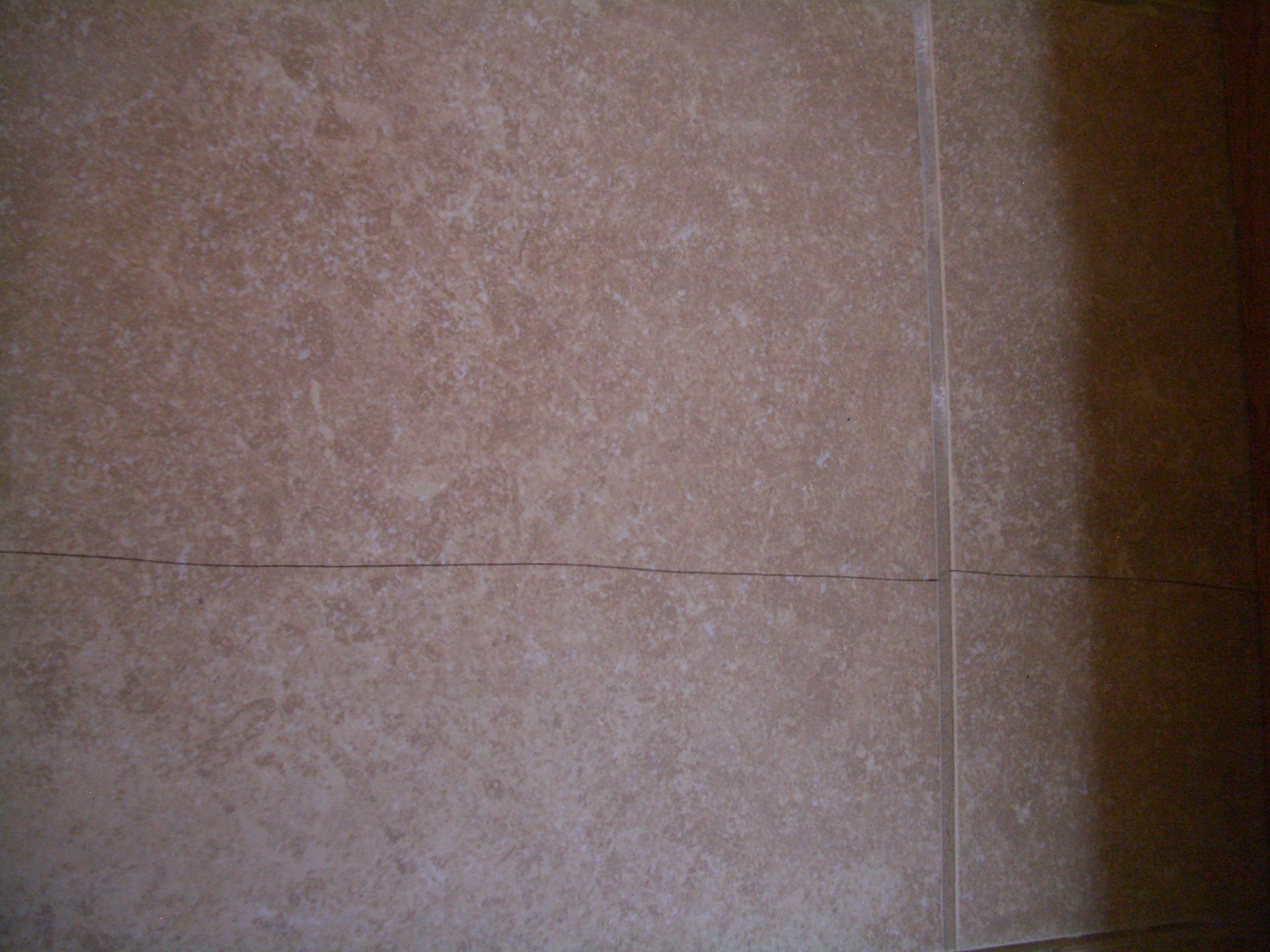 The importance of a properly installed backerboards cracked floor tile due to improper substrate preparation dailygadgetfo Images