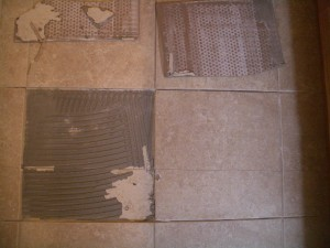 Improperly prepared substrate beneath cracked floor tile