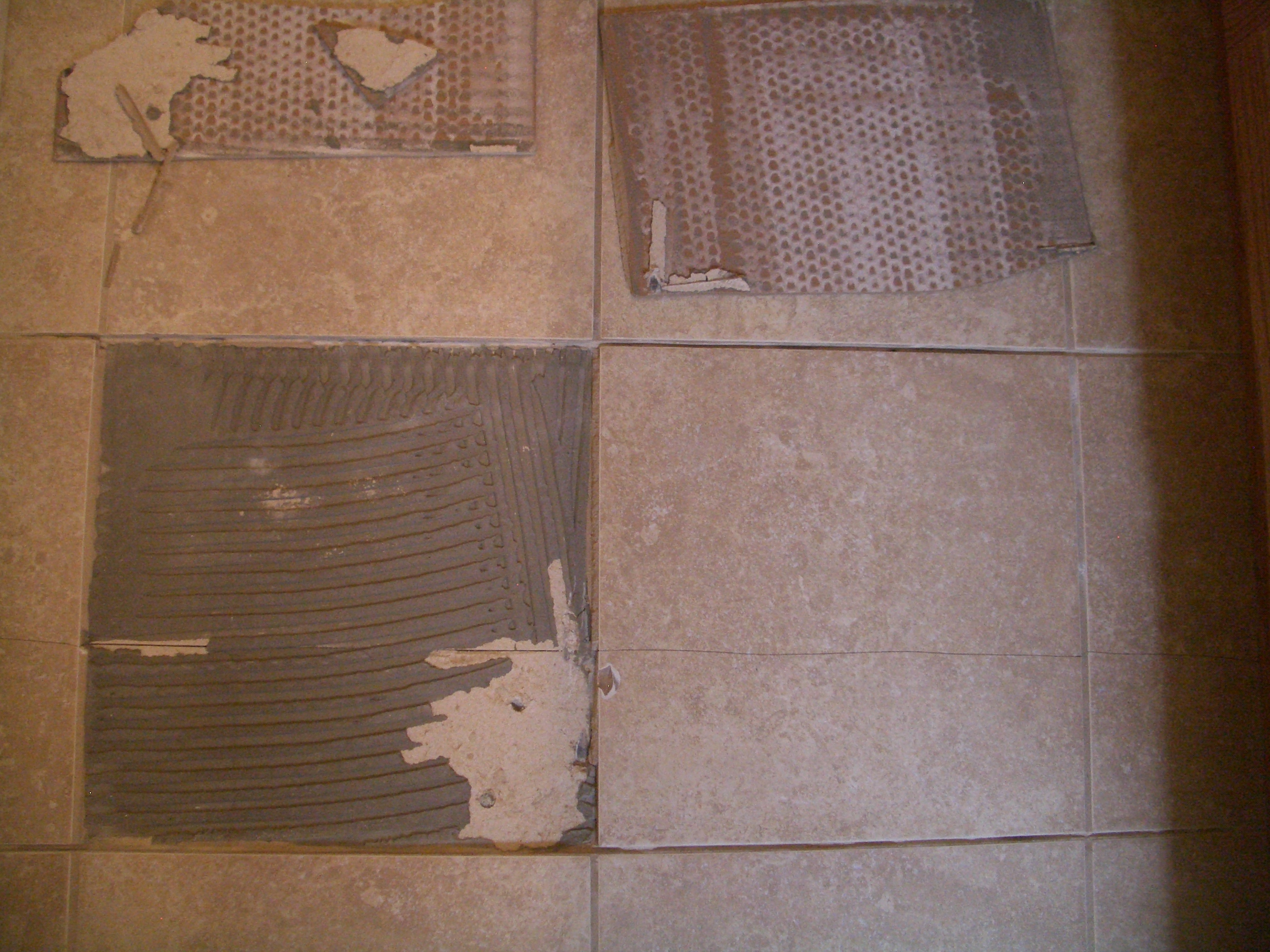 The importance of a properly installed backerboards improperly prepared substrate beneath cracked floor tile dailygadgetfo Images