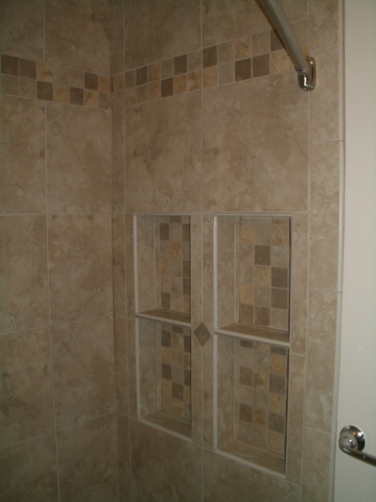 Tiled shower with backerboard transition
