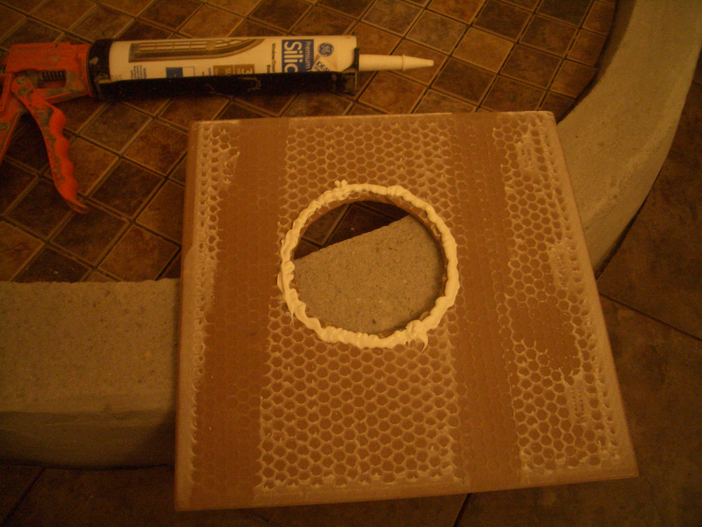 Cutout holes for fixtures in shower wall tile bead of silicone around hole perimeter dailygadgetfo Images