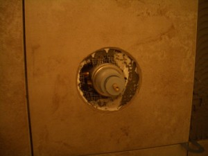 Tile installed with waterproofed cutout