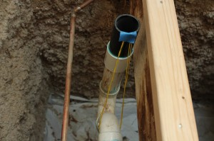 Tape the string to the top of the pipe