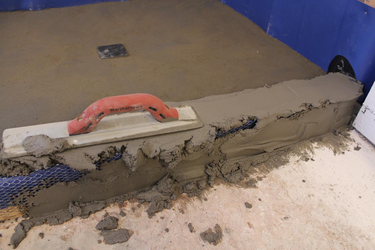 how to make a concrete shower curb