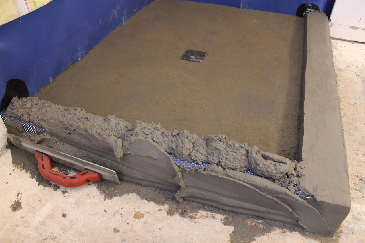 Creating a threshold or curb for your shower packing and embedding mud into lath dailygadgetfo Gallery