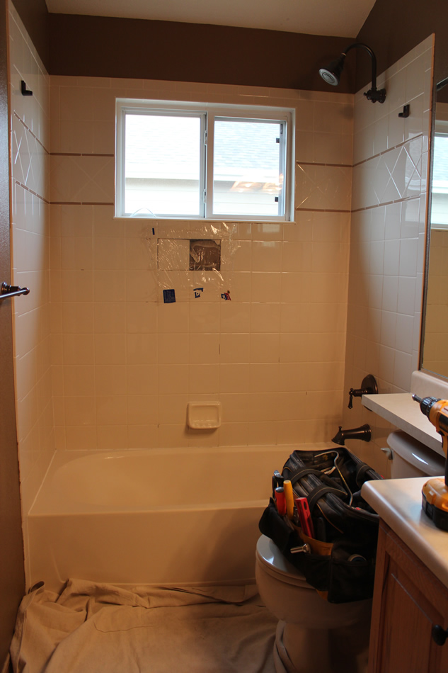 How to remove tiled shower walls. by Roger. Shower being removed