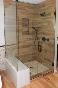 Plank shower with marble bench
